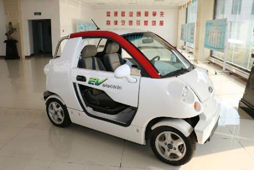 5吨标准煤排放的二氧化碳,所以要发展新能源汽车是势在必行.